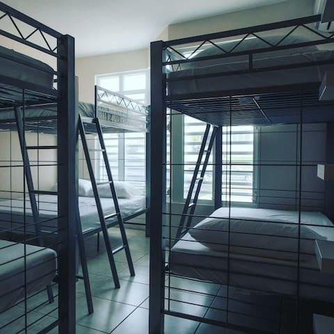 Room with 2 full bunk beds and 1 twin size bunk bed
