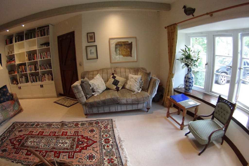 Spacious reception and living room area, with books, games and DVDs