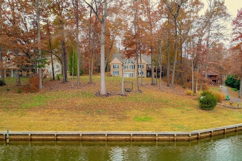 Stunning lakefront property w/dock, game/media rooms, large deck, and firepit!