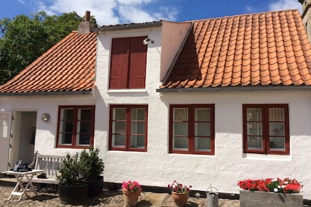 Charming cottage in historical courtyard