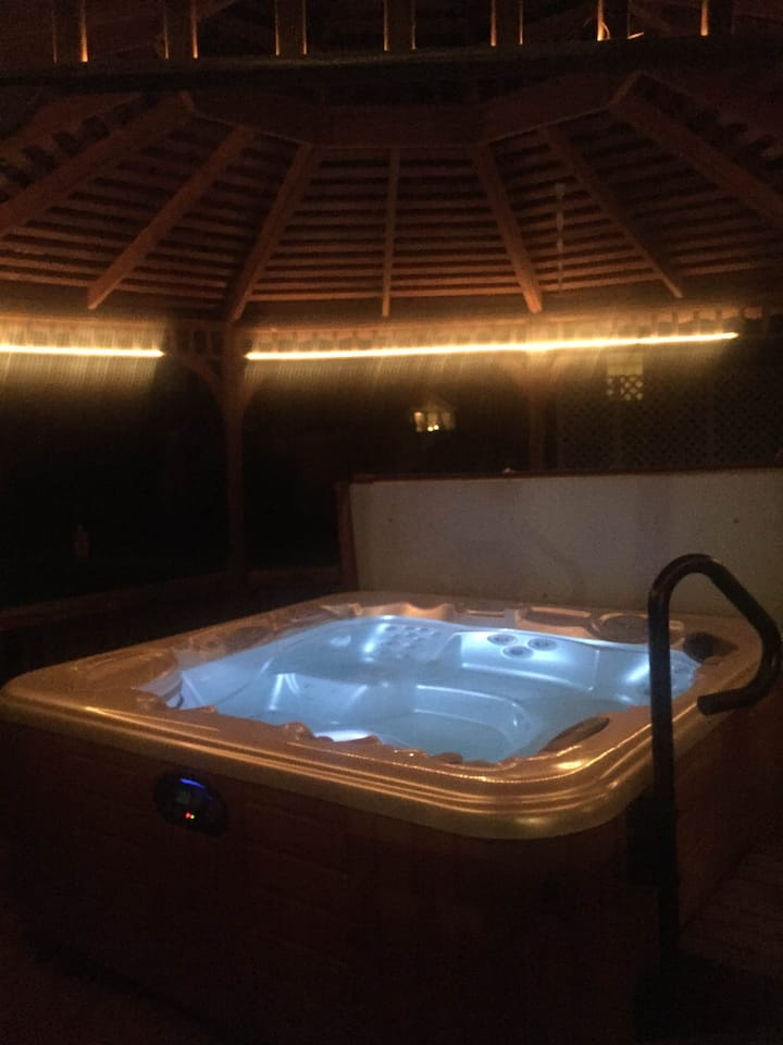 Stay warm and enjoy the hot tub & theater room