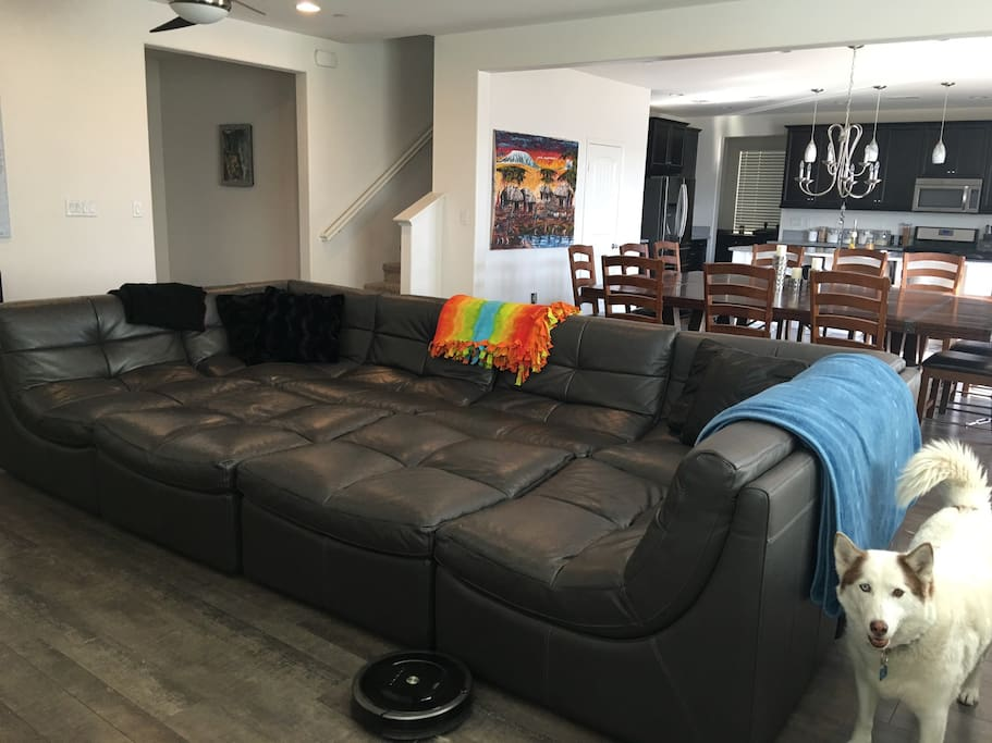 "Comfy couch with a 70"" TV"