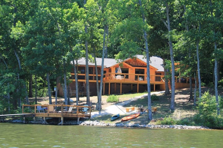 Dog-friendly, lakefront home in the woods w/ dock, private hot tub
