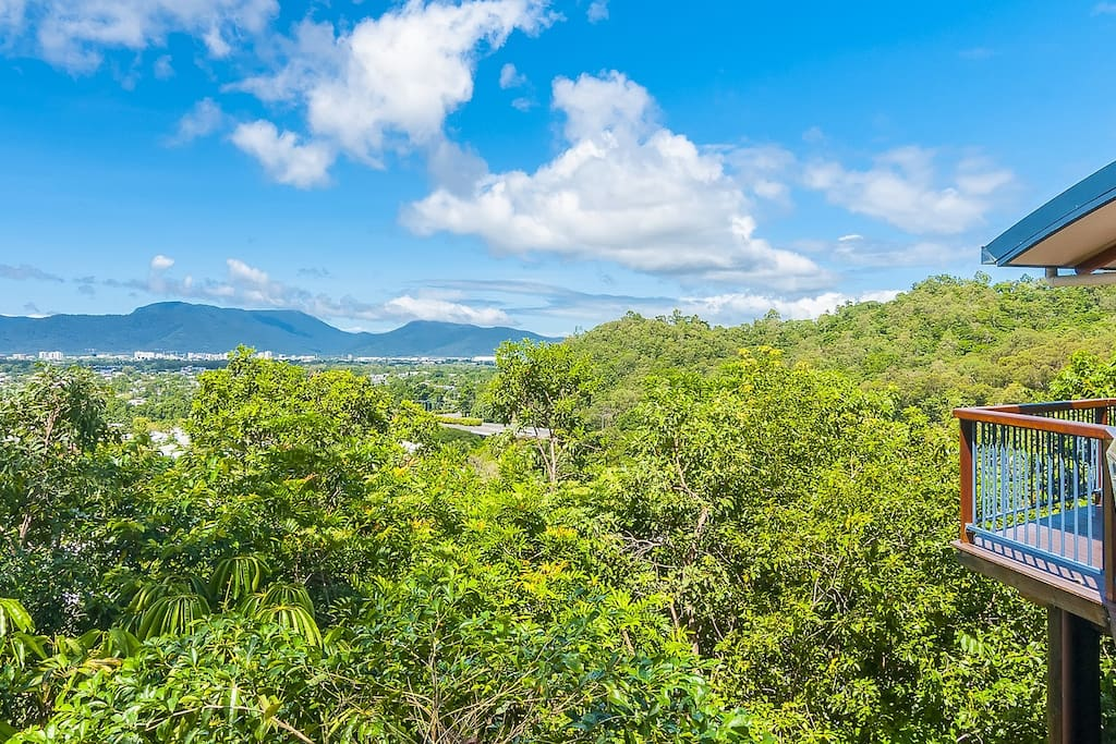 Enjoy views of the city and surrounding mountains in our tropical hideaway nestled on the hillside
