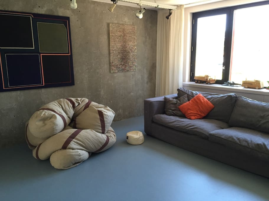 """Living room, with comfortable couch and the """"snake""""chair - loved by every kid for endless plays"""
