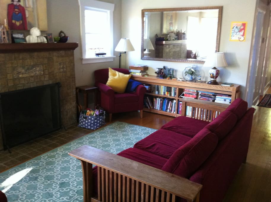 The living room is a comfortable place to enjoy a book or conversation.