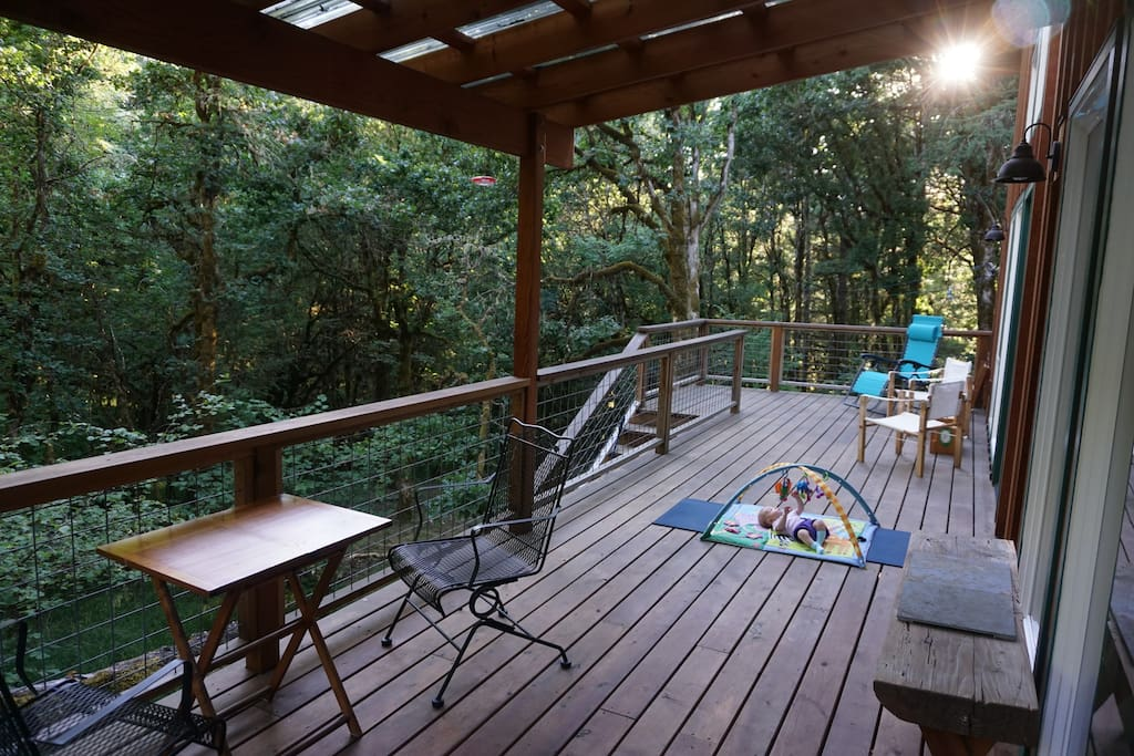 Spacious back deck overlooking the forest