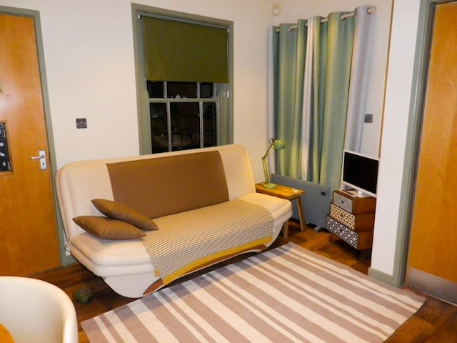 Double sofa-bed in living space for additional guests