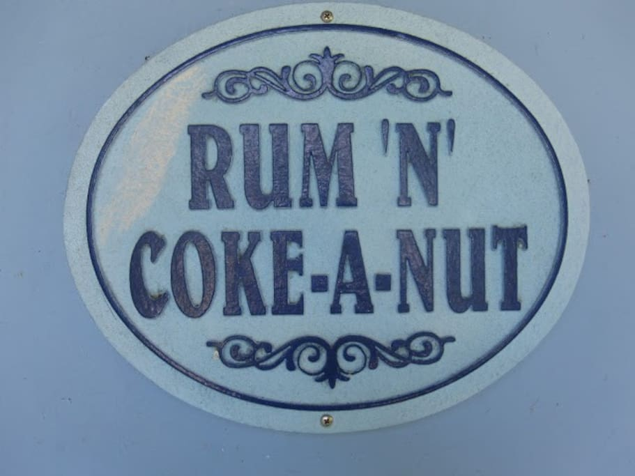 Sign at Coconut Tree in Front of the house