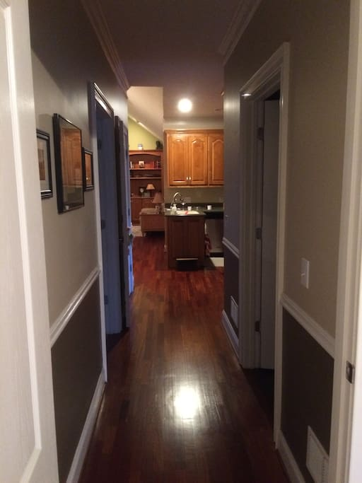 Dow the hall from kitchen & family room