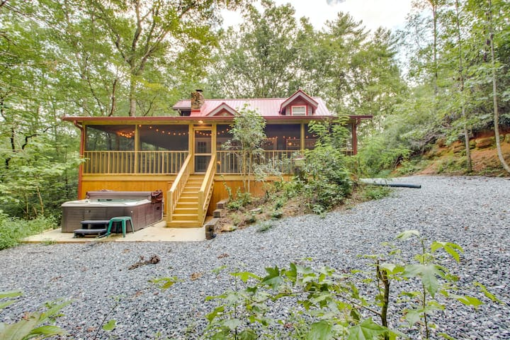 On 8 wooded acres w/ a creek! Enjoy private hot tub, screened-in deck & firepit