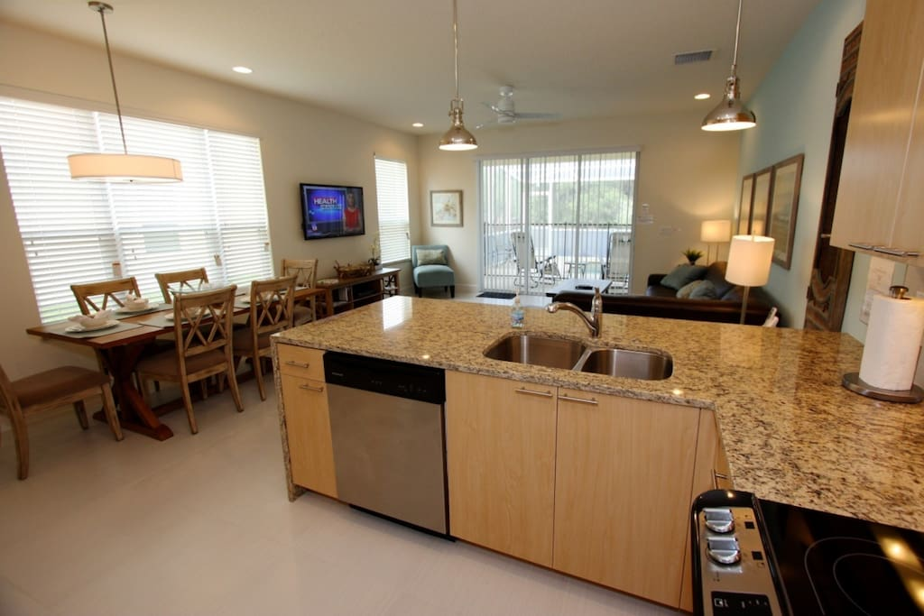 Kitchen is complete with caesarstone countertops and stainless steel appliances
