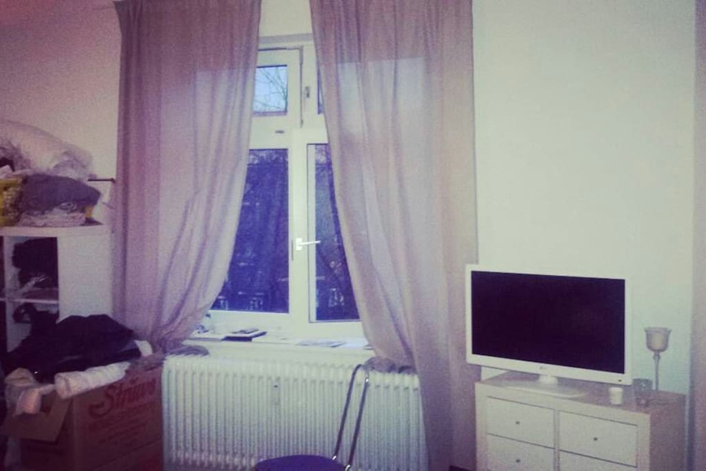 TV in the room (sorry for the boxes still not fully moved in :) )
