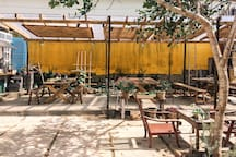 kitchen & outdoor dinning area behind the house, we provide free oven, microwave, water boiler, gas stove, rice cooker... then guests can cook & make bbq party by themselves