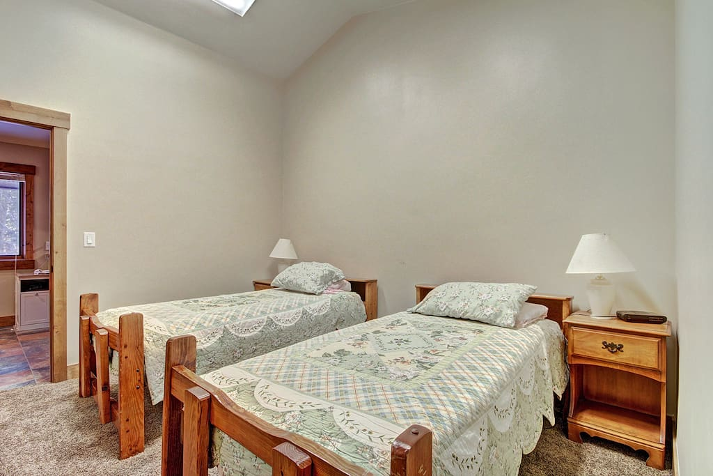 Kids room with two twins connects directly with master bedroom.