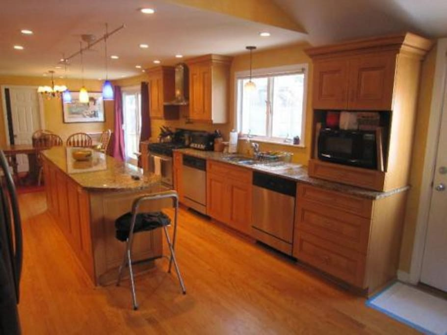 Large kitchen with marble counter tops, hardwood floors, 6 burner stove