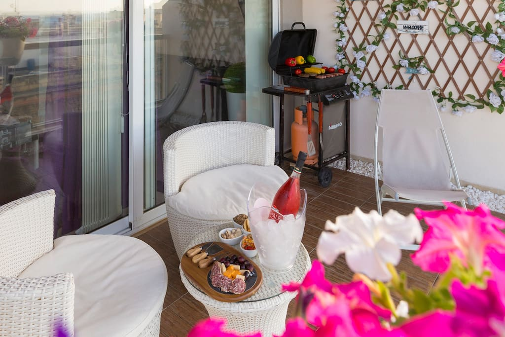 Balcony Area with outdoor furniture and BBQ