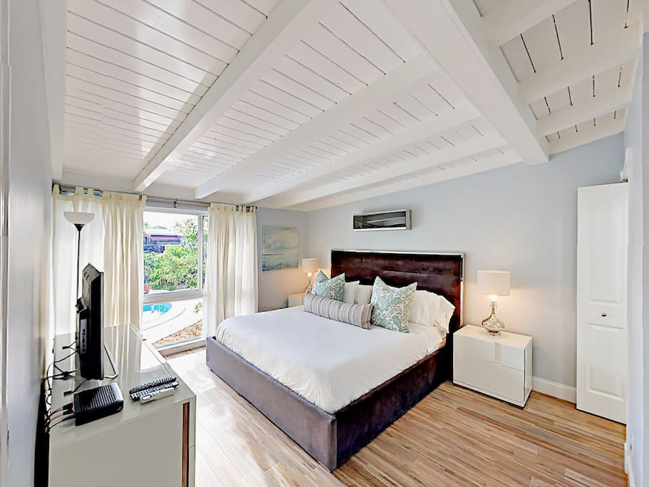 The master bedroom promises a restful slumber in a king bed with hotel-grade linens.