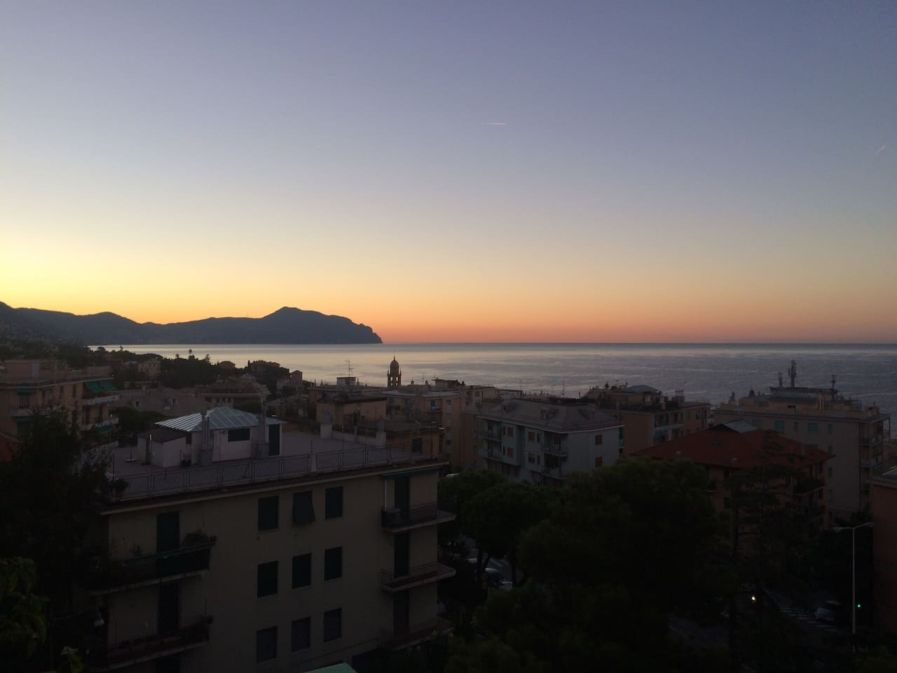 View of Sunrise  over Portofino from Bedroom window. Also available from balcony in lounge