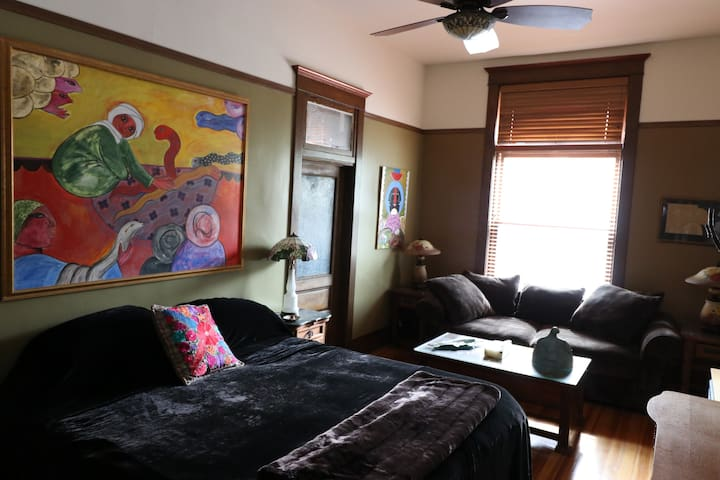 The room has a suite-style to it and is adorned by original artwork by Jesus Tells