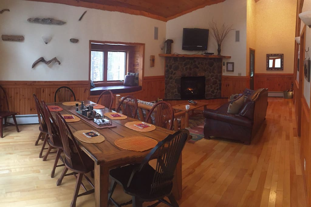 Dining and living room with window seat. TV has Hulu/Amazon streaming DVD player.