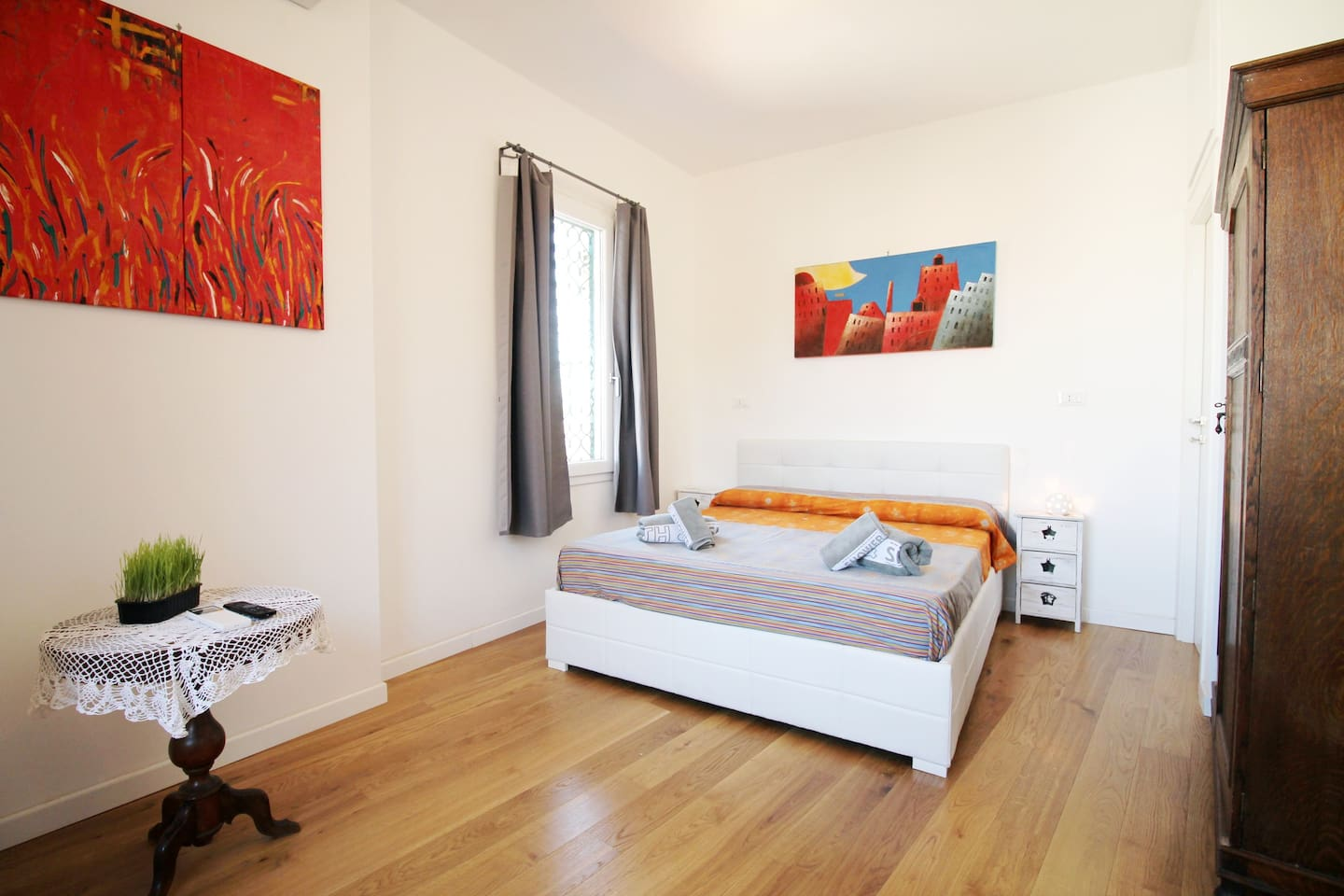 The spacious double bedroom with AC, TV and ensuite bathroom.