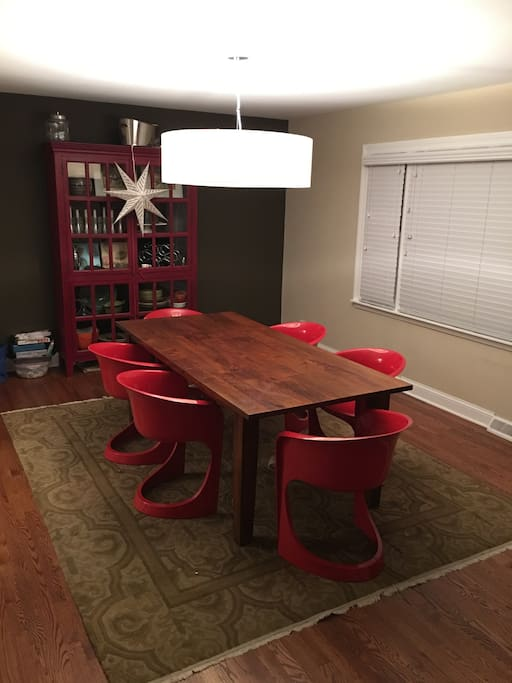 Warm, inviting  dining room with large table.