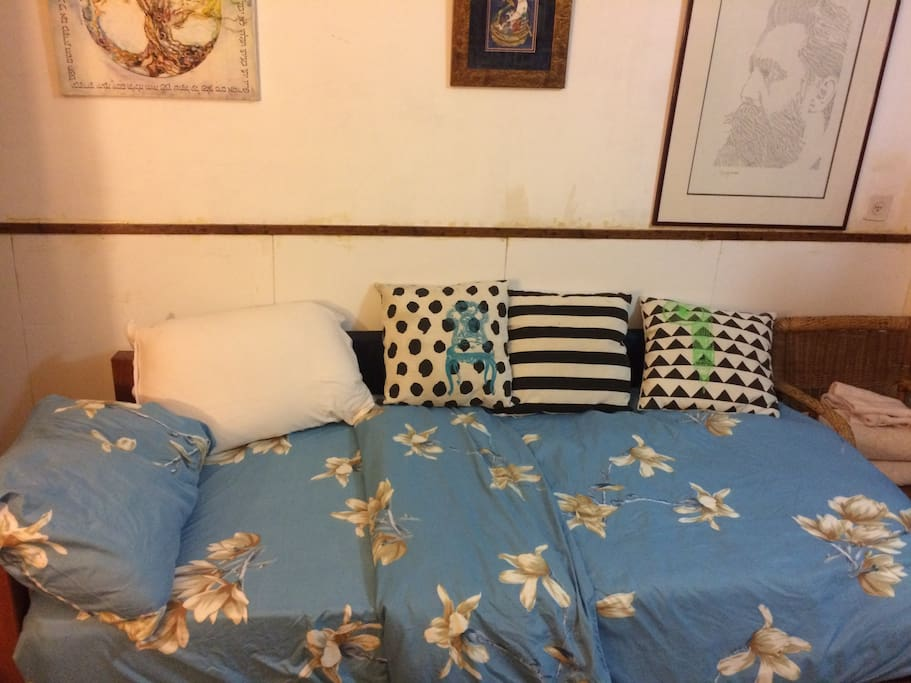 The bed with lots of pillows, and extra foam mattress