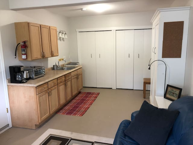 Simple, clean, efficient- complete with dishes & utensil, pots & pans, toaster/convection oven, 2 induction cooktops and bar fridge in closet. Lots of storage space.