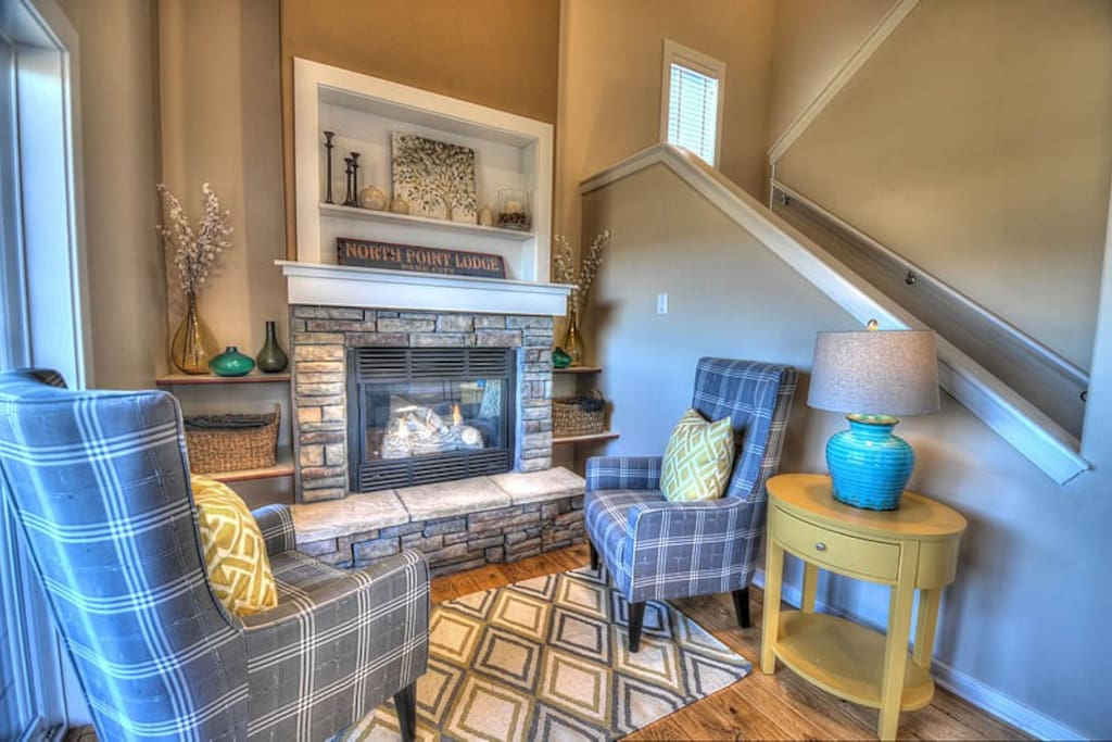 Cozy main level seating area with gas fireplace.