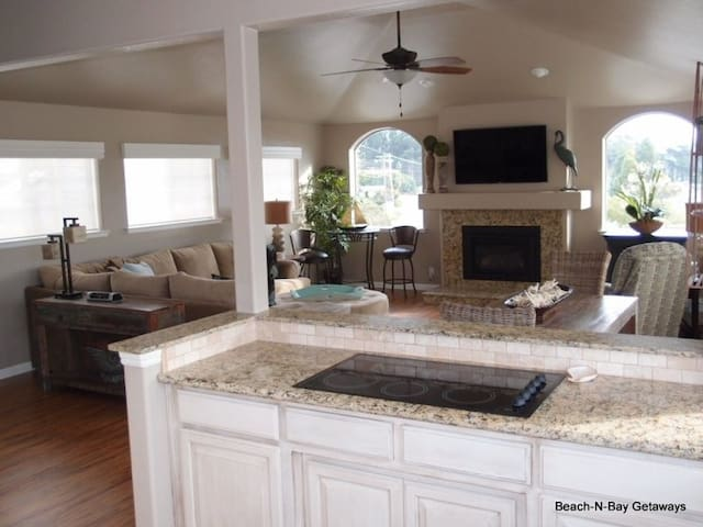 Living room, Dining Room, and Kitchen create a great space on the upper floor for visitng and hanging out.