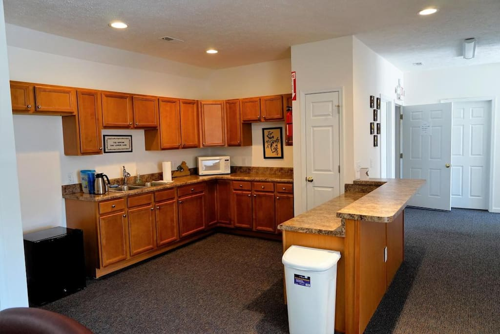 Kitchen includes a microwave, fridge, coffee maker