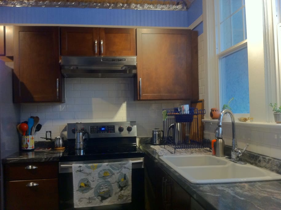 Newly renovated kitchen with new range and dishwasher