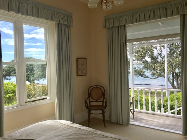 The Master Bedroom opens onto the front deck. It has magnificent views of the sea, an adjacent dressing room, and an ensuite bathroom.