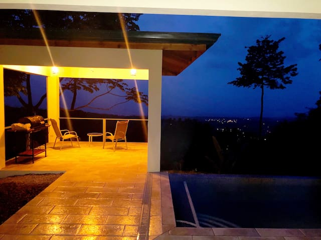 Night time overlooking Uvita lights as the pool beckons you.