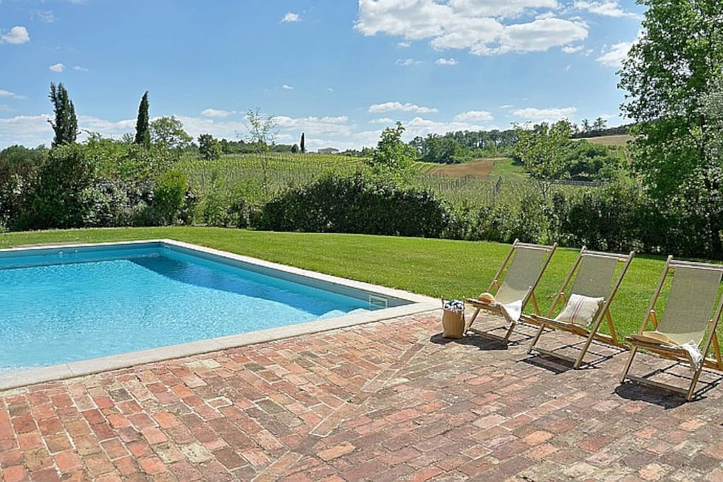 Take in the Tuscan countryside by the pool