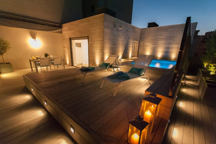 Terrace and pool. Night view