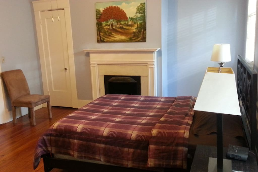 bedroom with decorative fireplace