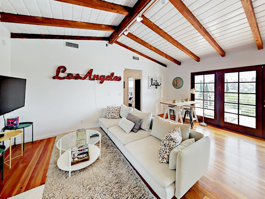 Your rental features an open and airy floor plan with hardwood flooring, vaulted ceilings, and abundant natural light.