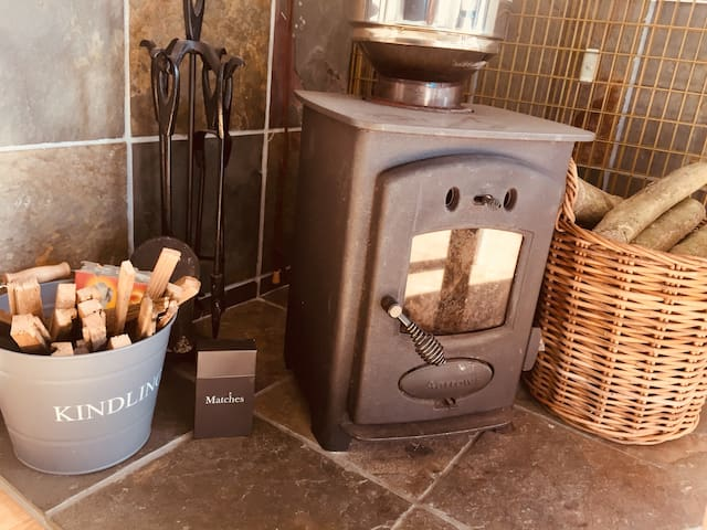 Little wood burner creates a warm cosy feel.