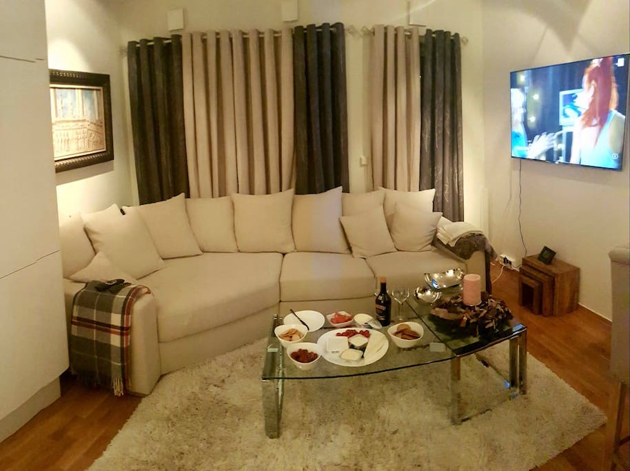 The cosy, modern living room. Since it is beside the kitchen, guests are welcome to enter and use the bar table and bar chairs, or go to the balcony. However, the couch is only for my personal use.