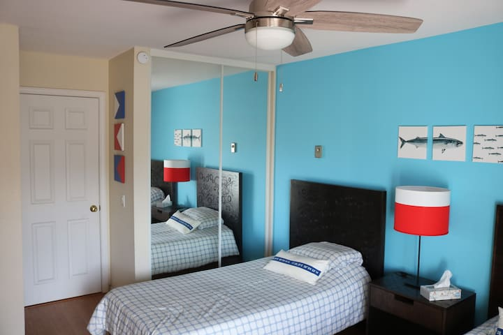 Bedroom 2, two single beds and two closets