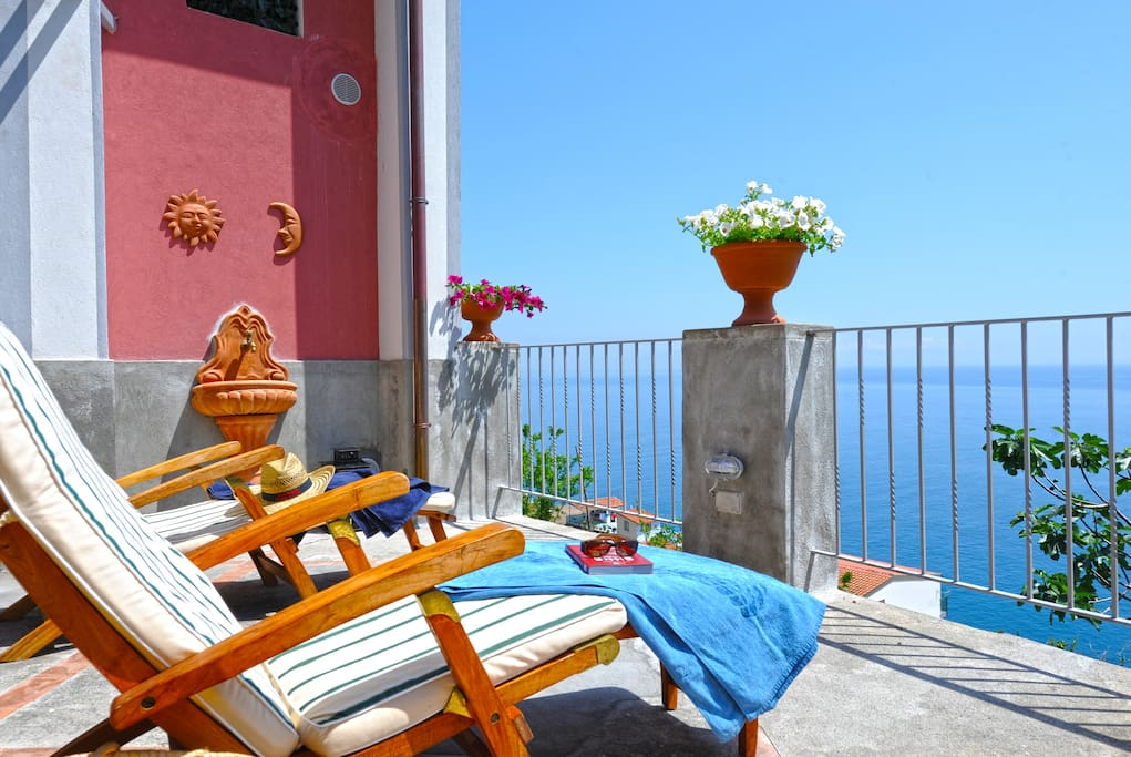 Large terrace with sun beds in wood with sea view