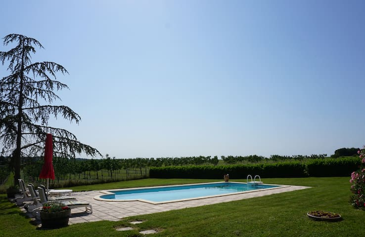 Private swimming pool with terrace & views across the countryside