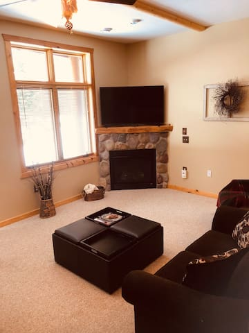 Living room with 55 inch flat screen tv and gas fireplace