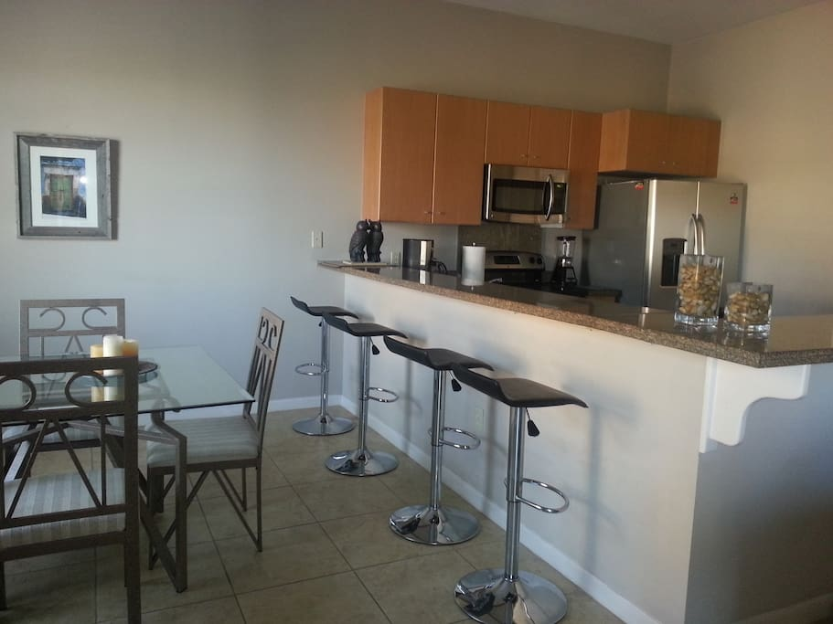 Dining room and open kitchen. I work on laptop at the granite countertop. Lots of convenient electrical outlets.