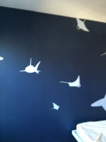 cool fish mural painted by former tenant