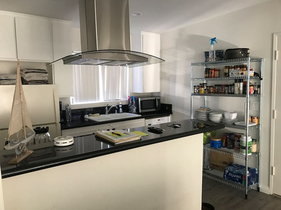 Remodeled kitchen with granite countertops. Stainless steel hood, oven, microwave and kitchen supplies to cook anything you want!