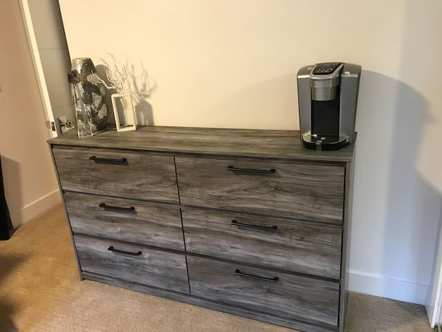 New dresser with plenty of storage space, new Kuerig K Cup coffee maker.