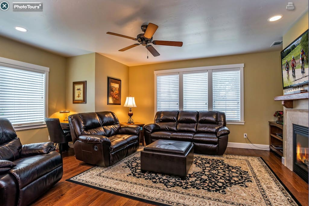 Open living room with cable TV, internet and fireplace..